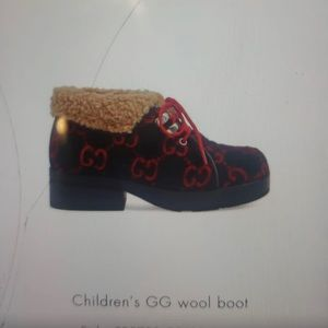 Gucci kids booties 👞 size 31 in  U.S size it's 13